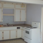 0ld kitchen with stove next to stair
