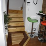 bottom of stair with birch inlay